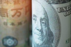 Gezichten van leidersamerikaanse dollar, Japanse Yen, bankbiljettenmunten van stock afbeeldingen