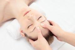 Gezichts massage Stock Afbeeldingen