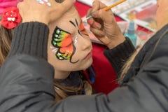 Gezichts schilderend kind stock afbeelding