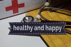 Gezond en gelukkig op het drukdocument met medisch en Gezondheidszorgconcept royalty-vrije stock afbeelding