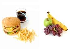 Gezond of ongezond voedsel Stock Afbeeldingen