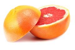 Gezond voedsel grapefruit op witte achtergrond wordt geïsoleerd die stock foto