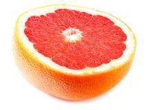 Gezond voedsel grapefruit op witte achtergrond wordt geïsoleerd die stock fotografie