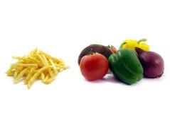 Gezond voedsel, ongezond voedsel Stock Foto's