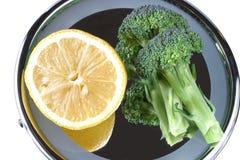 Gezonde bezinningen 0523 Ruwe citroen & broccoli Royalty-vrije Stock Afbeelding