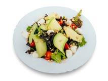 Gezonde en smakelijke zeevruchtensalade op een witte achtergrond in het restaurantmenu Het eten van concept Stock Afbeeldingen