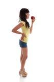 Gezonde vrouw die een appel eet royalty-vrije stock foto's