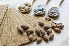 Gezonde zaden met neteltegels Stock Afbeeldingen