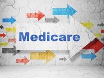 Gezondheidsconcept: pijl met Gezondheidszorg voor bejaarden op de achtergrond van de grungemuur Stock Afbeelding