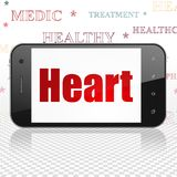 Gezondheidsconcept: Smartphone met Hart op vertoning Stock Foto's