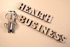 Gezondheidszaken De inschrijving van houten brieven en een teken van de metaaldollar Het concept corruptie in geneeskunde Ziekte  stock fotografie