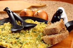 ägg pan förvanskat Arkivfoto