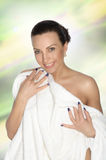Ggirl wrapped in a white towel Royalty Free Stock Images