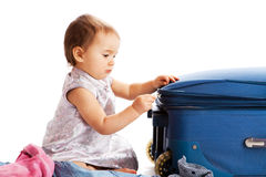 Ggirl zipping suitcase Royalty Free Stock Images