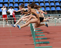 Ggirls at the hurdles race Royalty Free Stock Images