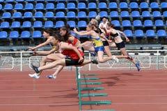 Ggirls at the hurdles race Royalty Free Stock Image