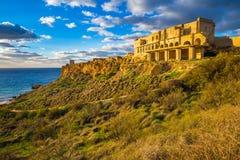 Ghajn Tuffeha, Malta - Golden hour at Ghajn Tuffieha beach on a lovely summer day with beautiful sky. And clouds Stock Photo