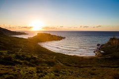 Ghajn Tuffieha Bay on Malta. Beautiful Ghajn Tuffieha Bay taken during colorful sunset on Malta island. Beautiful landscape in south Europe Stock Images