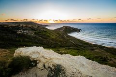 Ghajn Tuffieha Bay on Malta. Beautiful Ghajn Tuffieha Bay taken during colorful sunset on Malta island. Beautiful landscape in south Europe Royalty Free Stock Photography