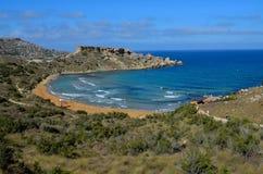 Ghajn Tuffieha Bay Malta. Ghajn Tuffieha Bay sandy beach Royalty Free Stock Photo