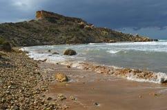 Ghajn Tuffieha Bay Malta. Shoreline waves on sandy beach Stock Images