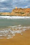 Ghajn Tuffieha Bay Malta. Shoreline waves on sandy beach Stock Photography