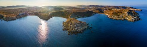 Ghajn Tuffieha, Malta - Aerial panoramic skyline view of the coast of Ghajn Tuffieha. With Golden Bay, Riviera Bay, Gnejna Bay at sunrise Royalty Free Stock Images