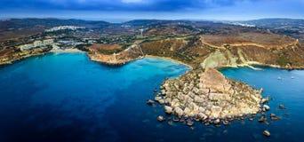Ghajn Tuffieha, Malta - Aerial panoramic skyline view of the coast of Ghajn Tuffieha with Golden Bay. Riviera Bay, Ghajn Tuffieha Watch Tower and other sandy Stock Image