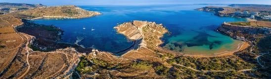 Ghajn Tuffieha, Malta - Aerial panoramic view of the coast of Ghajn Tuffieha with Gnejna Bay. Riviera Bay and Golden Bay at sunrise Stock Photo