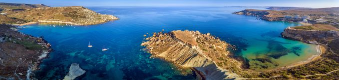 Ghajn Tuffieha, Malta - Aerial panoramic view of the coast of Ghajn Tuffieha with Gnejna Bay, Riviera Bay. And Golden Bay at sunrise Royalty Free Stock Photography