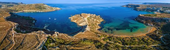 Ghajn Tuffieha, Malta - Aerial panoramic view of the coast of Ghajn Tuffieha with Gnejna Bay, Riviera Bay and Golden Bay. At sunrise Royalty Free Stock Photography