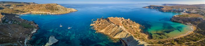 Ghajn Tuffieha, Malta - Aerial panoramic view of the coast of Ghajn Tuffieha with Gnejna Bay. Riviera Bay and Golden Bay at sunrise Royalty Free Stock Images