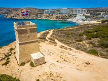 Ghajn Tuffieha, Malta - Beautiful Ghajn Tuffieha Watch Tower and Golden Bay beach from above. On a bright summer day with clear blue sky Stock Photography
