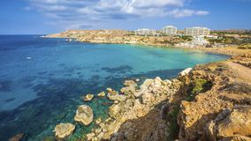 Ghajn Tuffieha, Malta - Panoramic skyline view of Golden Bay, Ma. Lta`s most beautiful sandy beach on a nice summer day with blue sky and clouds Stock Photo
