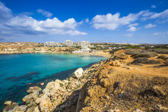 Ghajn Tuffieha, Malta - Panoramic skyline view of Golden Bay. Malta`s most beautiful sandy beach on a nice summer day with blue sky and clouds Stock Image