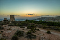 Ghajn Tuffieha Tower in Golden Bay at sunset - Malta Stock Images