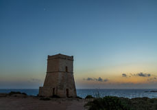 Ghajn Tuffieha Tower in Golden Bay at sunset - Malta Royalty Free Stock Images