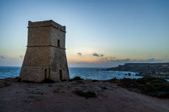 Ghajn Tuffieha Tower in Golden Bay at sunset - Malta Stock Image