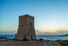Ghajn Tuffieha Tower in Golden Bay at sunset - Malta Royalty Free Stock Photo