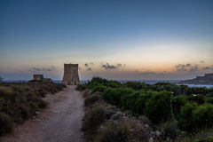 Ghajn Tuffieha Tower in Golden Bay at sunset - Malta Royalty Free Stock Image