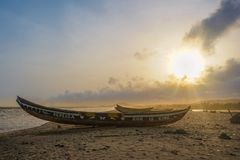 Ghana Boat Sunset Accra. Ghana Boat Accra Kokrobite Sunset Yellow Oldboat wood beach sand ocean weather nature african africa royalty free stock images