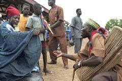 Ghanaian musician asks for money to village elder. Ghana, district of Savelugu Nanton, North Ghana region, place Savelugu: during the festivities of the opening Stock Photos