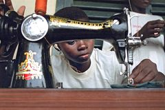 Portrait of sewing Ghanaian girl. Ghana, district Savelugu Nanton, region North Ghana, place Savelugu: A girl with a disability, she is quite deaf despite the Royalty Free Stock Photos