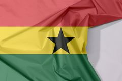 Ghana fabric flag crepe and crease with white space. Ghana fabric flag crepe and crease with white space, horizontal triband of red, gold, and green with black royalty free stock image