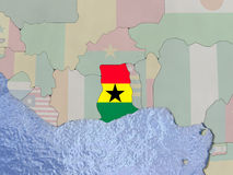 Ghana with flag on globe Stock Images