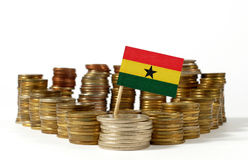 Ghana flag with stack of money coins Stock Photo