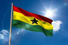 Ghana national flag on flagpole Royalty Free Stock Image
