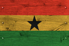 Ghana national flag painted old oak wood fastened. Ghana, Ghanese national flag painted on old oak wood. Painting is colorful on planks of train carriage stock illustration