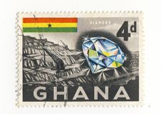 Ghana stamp w/diamond and mine. A stamp from ghana showing a sparkling diamond and a mine Stock Photo