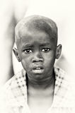 A Ghanaian boy with asking eyes Royalty Free Stock Images